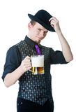 Man in black hat with mug of beer Royalty Free Stock Photo