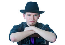 Man in black hat sitting on chair Stock Photos