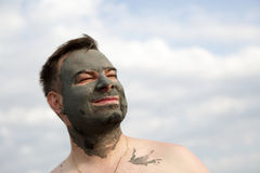 Man with black healthy mud Stock Image
