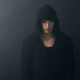 Man in black hoodie looking confidently Royalty Free Stock Photos