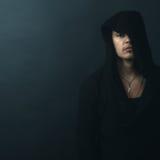 Man in black hoodie upset Royalty Free Stock Images