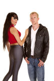 Man in black jacket front woman gray pants back both looking Royalty Free Stock Photography
