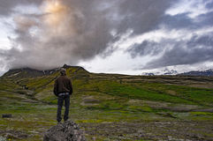Man in Black Jacket on the Peak Under Gray Sky Royalty Free Stock Photos