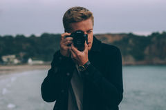 Man in Black Jacket Taking Photo With Dslr Camera Royalty Free Stock Photography