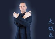 Man in Black Kimono, running moves of tai chi stock image