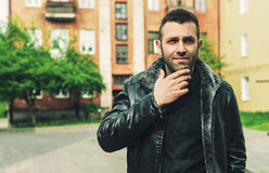 Man in black leather jacket Stock Images