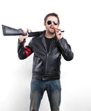 Man in black leather jacket, sunglasses and cigar with gun Royalty Free Stock Image