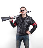 Man in black leather jacket, sunglasses and cigar with shotgun.  Stock Image