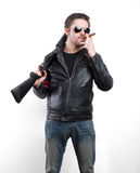 Man in black leather jacket, sunglasses and cigar with shotgun Stock Photo