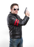 Man in black leather jacket and sunglasses with gun Royalty Free Stock Photo