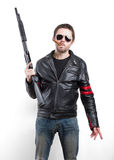 Man in black leather jacket and sunglasses with shotgun Royalty Free Stock Photos