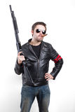 Man in black leather jacket and sunglasses with shotgun Stock Photography