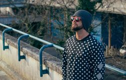 Man model with beard and sunglasses in London city in black jacket stock images