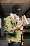 Man in black mash manipulating flammable bottle Royalty Free Stock Photos