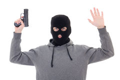 Man in black mask with gun holding hands up isolated on white Royalty Free Stock Photos