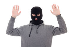 Man in black mask holding hands up isolated on white Stock Photo