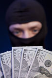 Man in black mask holding the money Stock Images
