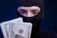 Man in black mask holding the money Royalty Free Stock Image