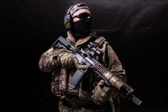 Man in black mask with rifle Stock Photo