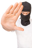 Man in black mask says stop to crime Stock Photography