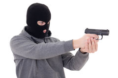 Man in black mask shooting with gun isolated on white Stock Images