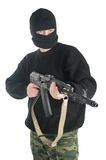 Man in black mask stands with AK-74 machine gun Royalty Free Stock Image