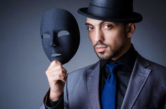 Man. With black mask in studio Stock Photography