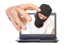 Man in black mask tries to grab the viewer from the screen Stock Images