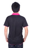 Man in black polo shirt isolated on white background back side. Man in black polo shirt isolated on a white background back side Royalty Free Stock Images