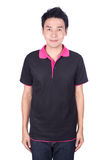 Man in black polo shirt isolated on white background. Happy man in black polo shirt isolated on white background Royalty Free Stock Photos