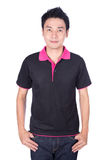 Man in black polo shirt isolated on white background. Happy man in black polo shirt isolated on white background Royalty Free Stock Photography