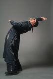 Man in a black raincoat Stock Photography