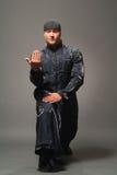 Man in a black raincoat Stock Photo