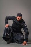 Man in a black raincoat Stock Image
