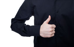 Businessman giving thumbs up on white background Royalty Free Stock Image
