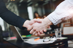 Man in black shirt handshakes man in white shirt after efficient business meeting. Man in black shirt handshakes men in white shirt after efficient business royalty free stock photos