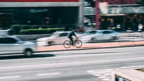 Man in Black Shirt Using Black Road Bicycle Royalty Free Stock Image