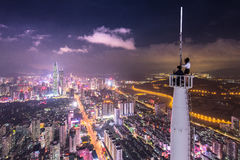 Man in Black Shirt Beside Woman in White Longsleeve Shirt on White Tower Looking at City during Night Time Stock Photos