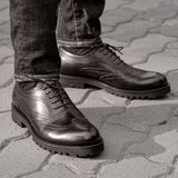 A man in the street wearing black shoes. Man in black shoes brogues. A man in the street wearing black shoes royalty free stock images