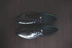 Man black shoes on wood background Stock Photo