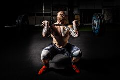 Man in Black Shorts Carrying Adjustable Barbells Stock Photography