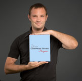Man in black showing a blank package Stock Photography
