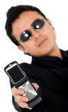 Man in black showing a phone Royalty Free Stock Photography