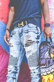 Man in Black Sleeveless Shirt and Washed Blue Denim Tattered Jeans Stock Images