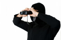 Man in black with Spyglass Stock Photo