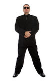 Man in black suit. Tall man in black suit and sunglasses royalty free stock photography