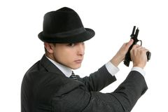 man with black suit and gun Royalty Free Stock Photos