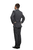 Man in black suit with hands on belt Royalty Free Stock Photo