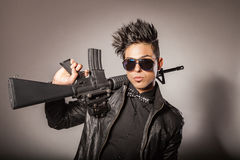 Man in black suit holding gun. Stock Photo