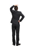Man in black suit looking up Stock Photo